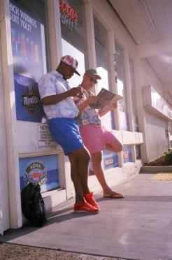 Bright shorts and Hawaiian shirts